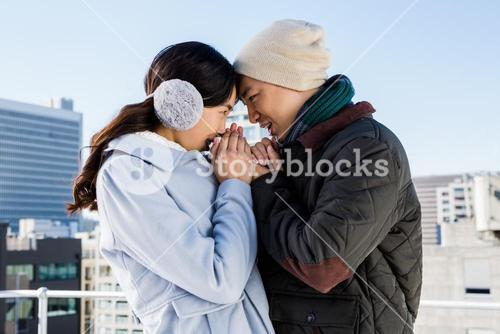 Affectionate couple in winter clothing
