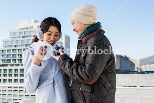 Surprised woman being proposed by boyfriend