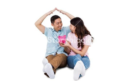 Happy young couple with piggy bak