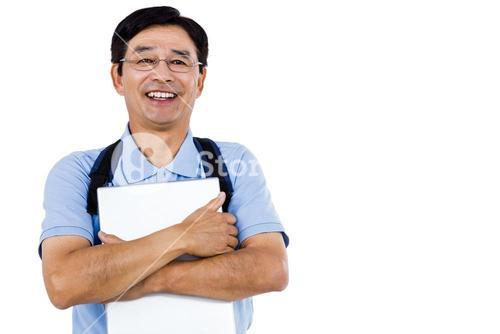 Portrait of cheerful man holding documents