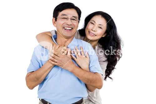 Smiling couple holding each other