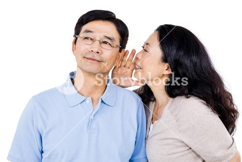 Woman whispering into partners ear