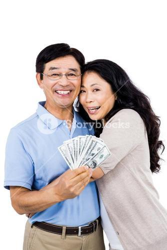 Smiling couple with cash in hand