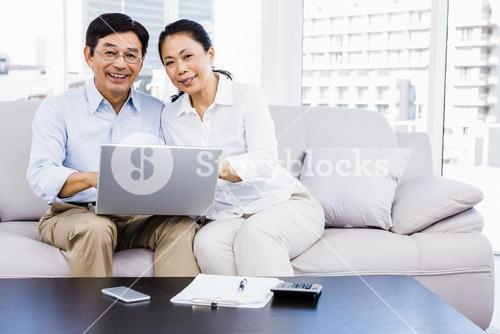 Smiling man at home on couch