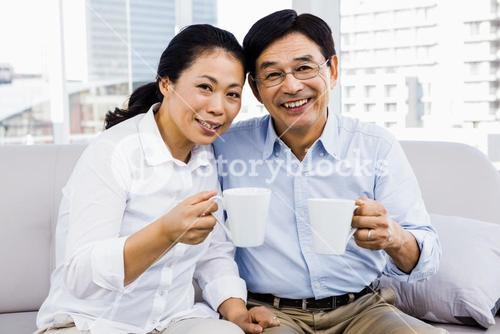Potrait of couple enjoying coffee on the couch