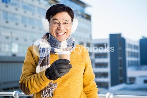 Older asian man with coffee to go