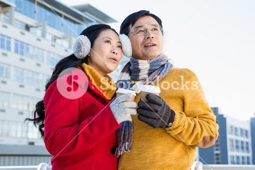 Older asian couple with coffee to go