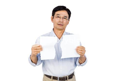 Older asian man showing ripped page