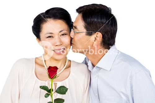 Older asian couple with rose