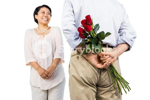 Older asian couple with roses