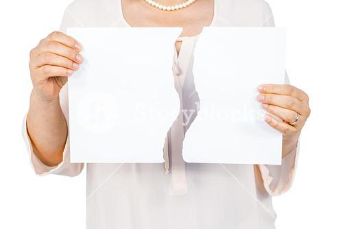 Woman holding ripped page