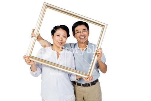 Older asian couple with frame