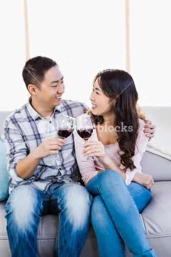 Happy couple holding wineglasses