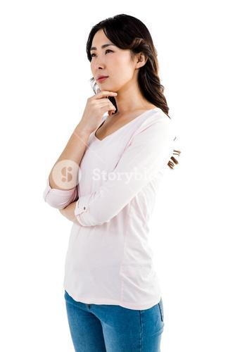 Thoughtful woman with hand on cheek