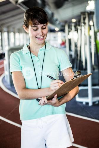Smiling trainer with notes
