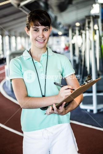 trainer with notes smiling