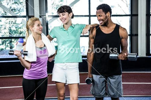 Fit smiling people standing together