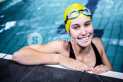 Swimmer woman lean on the edge of the swimming pool