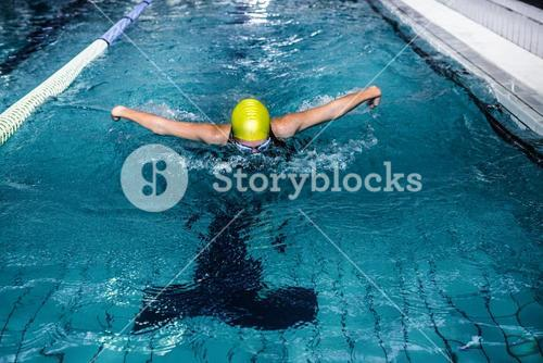 Swimmer woman swimming in the swimming pool