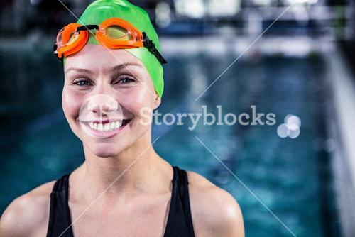 Portrait of a woman swimmer looking the camera