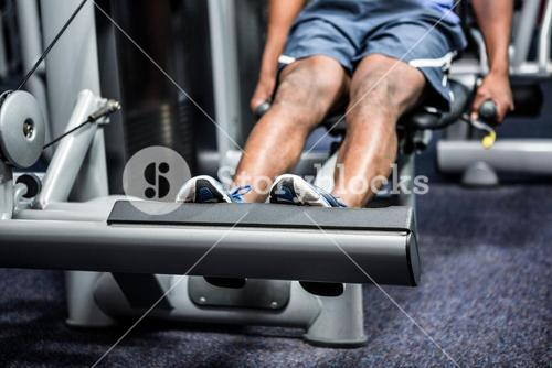 Cropped image of man using exercise machine
