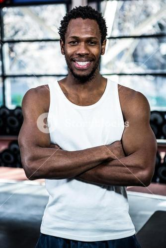 Muscular man posing with crossed arms