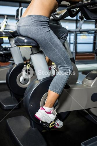 Mid section of woman doing bike exercise