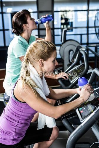 Fit women doing exercise bike