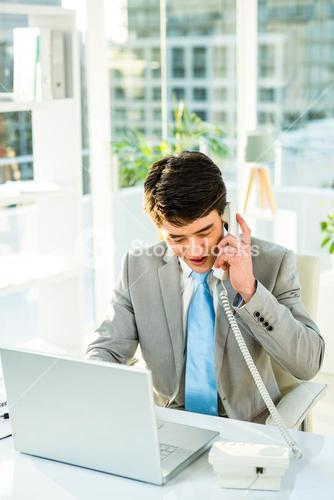 Asian businessman talking on the telephone