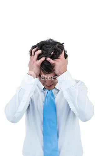 Irritated asian businessman holding his head