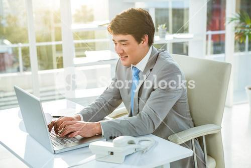 Asian businessman using his computer