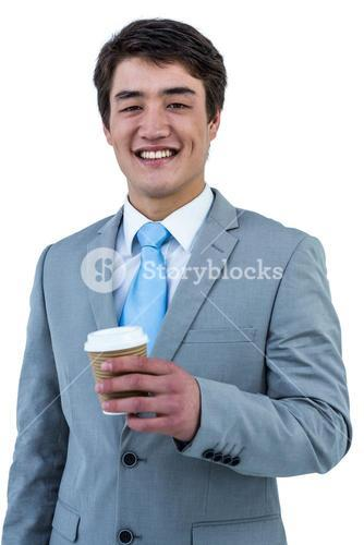 Smiling asian businessman drinking coffee