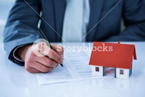 Businessman signing contract for new house