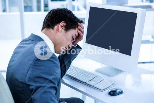 Tired businessman holding his head