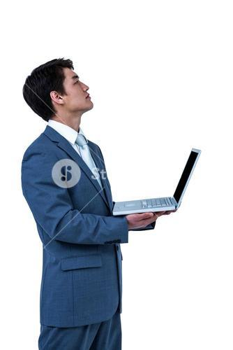 Businessman look away with his computer