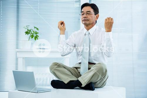 Peaceful asian businessman relaxing