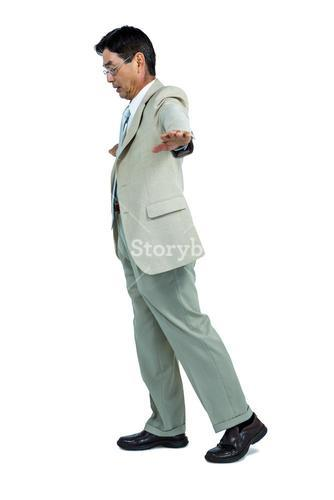 Focused businessman walking straight ahead