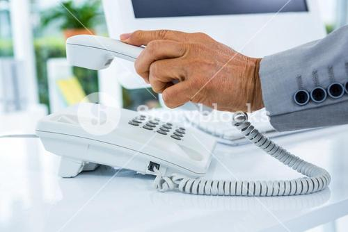 Businessman answering the phone