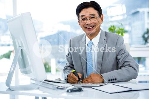 Portrait of happy businessman working