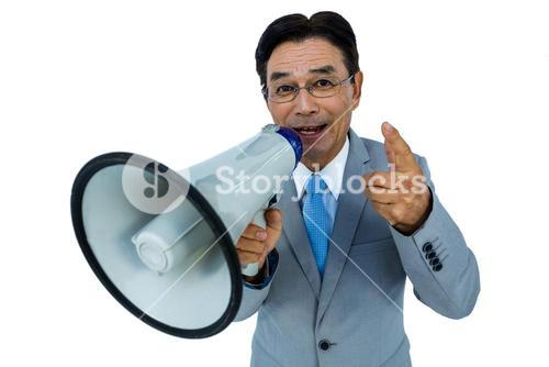 Asian businessman talking through megaphone