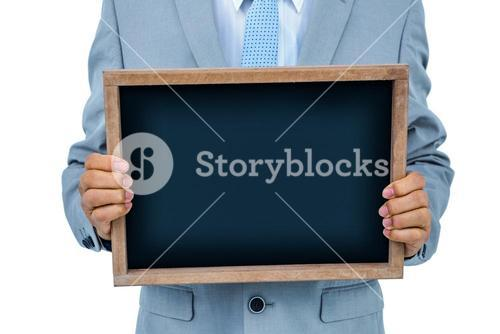Businessman showing black board