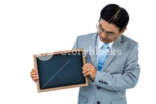 Asian businessman holding a black board