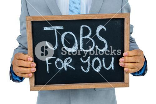 Businessman holding black board