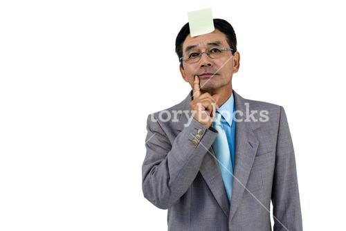 Businessman with blank note on forehead