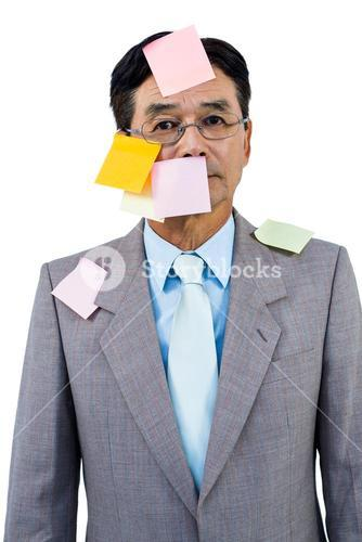 Businessman with blank note over his face