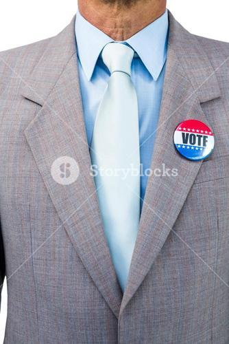 Businessman posing with badge