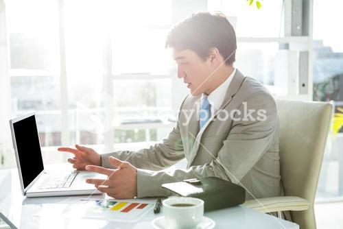 Asian businessman on his desk
