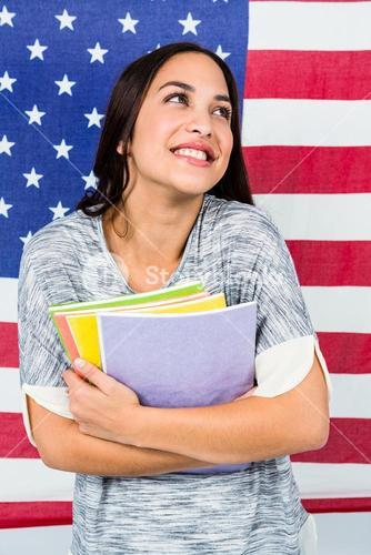 Smiling woman against American flag