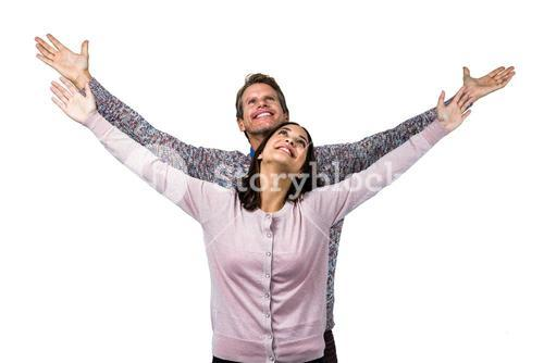 Smiling couple with arms raised