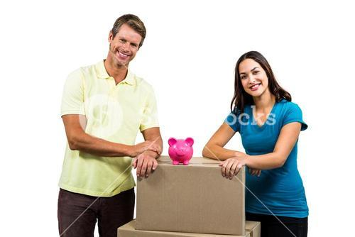 Portrait of smiling couple with boxes